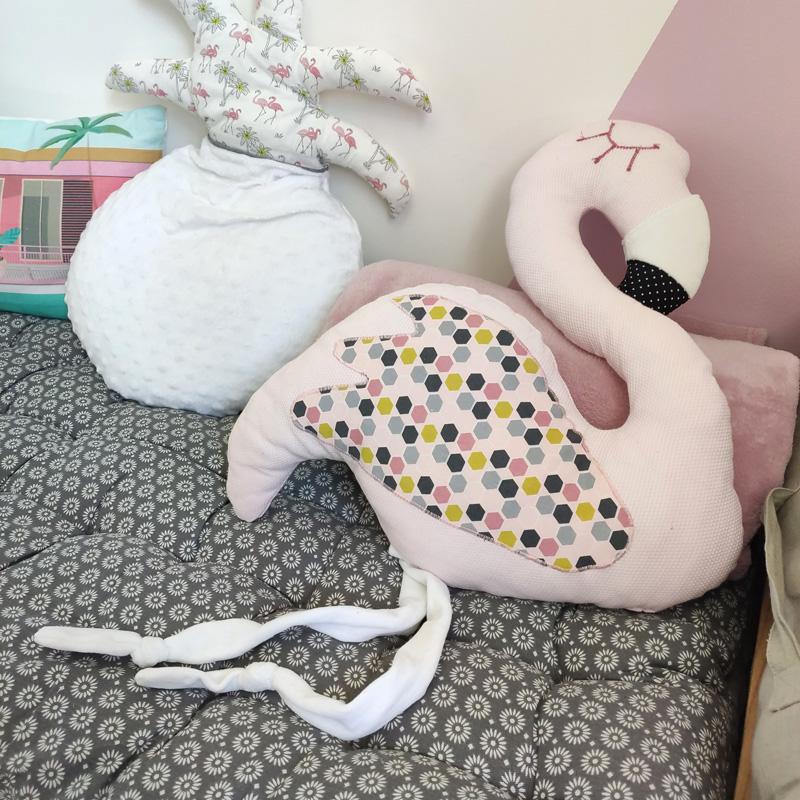 coussins rose et blanc